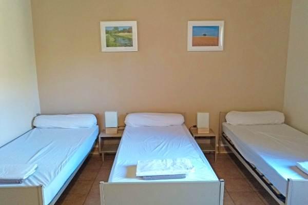 Chambre de 4 lits au rez-de-chaussée.