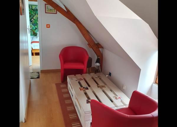 Espace lecture/jeu entre les 2 chambres à l'étage