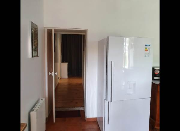 De la cuisine vers le couloir des chambres du RC